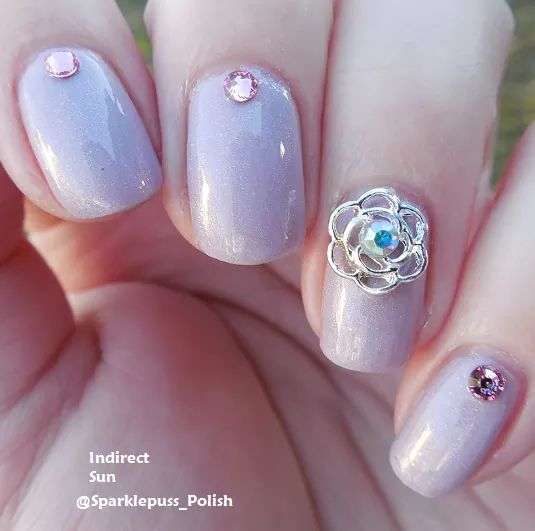 Petal To The Metal by Octopus Party Nail Lacquer with charms from Nail Art Elegance